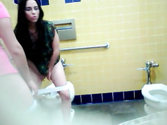 Latina girls get caught on spycam pissing really hard