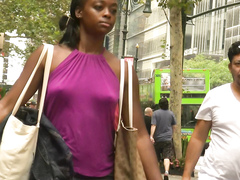 Ebony goddess walks around without any bra on