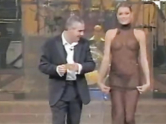 Extravagant TV presenter in the transparent dress