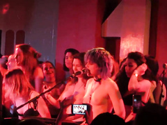 Delicious babes jump on the stage and remove their shirts and bras