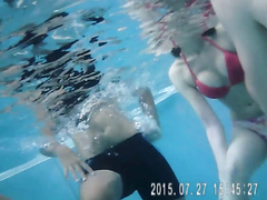 Gorgeous babes fool around with their men in the pool