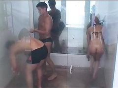 Lovely girl and two guys taking a long shower