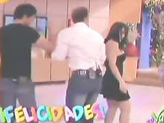 Busty lady demonstrates her juicy ass on the television