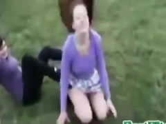 Redhead coed performs a somersault in a short skirt