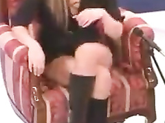 Desirable woman crosses her legs and reveals panties