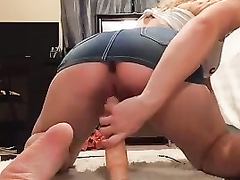 Gorgeous blonde hunny with a big butt slides a large dildo in her twat