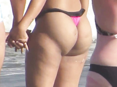 Huge booty bounces on the beach as this hot Brazilian babe has fun