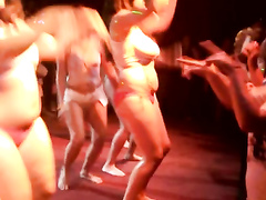 Playful bimbos get crazy and wet while dancing in the club