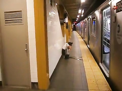 Drunk coed relieves herself at a metro station