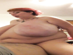 Tasty redhead BBW enjoys riding hard on a throbbing penis