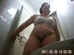 Hairy cougar empties the bladder in front of the hidden camera