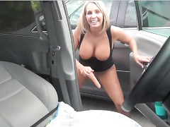 Gorgeous blonde playing with her toy collection on the parking lot