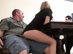 Slim blonde secretary rides her boss's cock in front of people