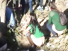 Festival girls caught peeing in the nature