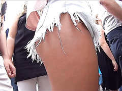 Foxy stunners wearing tight shorts have their butts recorded
