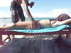 Desirable dish lets her man put sunscreen on her slim body