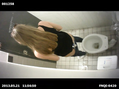 Slim long-haired brunette takes a quick whiz in the restroom