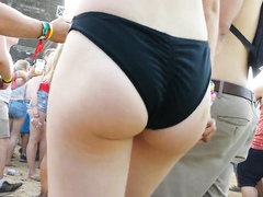 Slender honey wears black outfit that exposes the lower part of her butt