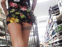 Slim daring girl spreads firm butt cheeks in the supermarket