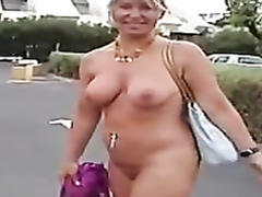 Lady walks around the beach town in her birthday suit