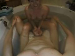 Slim girlfiend does a hot handjob on cam in the tub