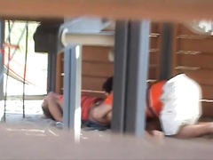 Adults copulating on the playground while filmed