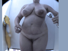 Fat amateur mature with big tits spied in the shower