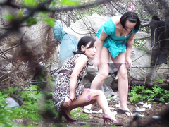 Girls filmed peeing in the city park by horny voyeur