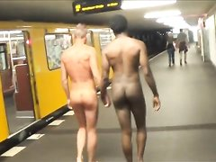 Gay exhibitionists walk naked down street