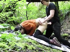 Lesbian strap-on sex outdoors