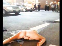 Naked drunk woman in the street