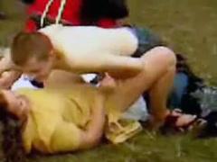 German couple has public sex in a grassy field