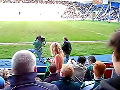 Female fan goes streaking at a football match