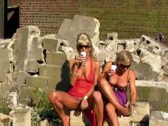 Blondes piss on slave men in kinky outdoor scene