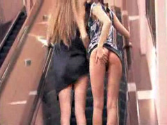 Sexy upskirt view with two sweet girls on an escalator