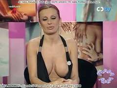 Yummy nipple slip in low cut dress on Spanish TV