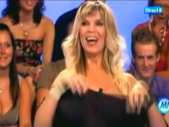 Bimbo babe on TV flashes her big boobies