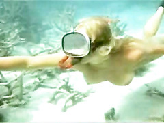 Naked Helen Mirren snorkeling in the ocean