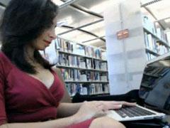 Gorgeous babe in a crimson dress makes public webcam tease
