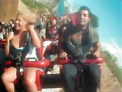 Roller coaster ride makes her big tits pop out