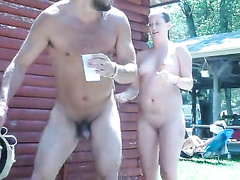 Nudist girl takes a shower in the open air