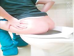 Amateur girl takes a plop in a public lavatory