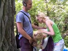 Blonde teens suck his dick lustily outdoors