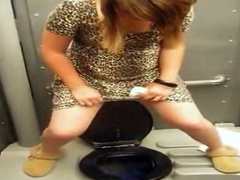 Cute girl filmed pissing over an outdoor toilet