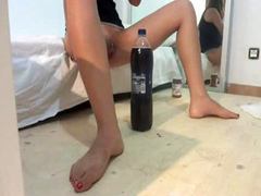 Big soda bottle stretches her amateur pussy