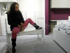 Naughty German beauty peeing in the furniture store