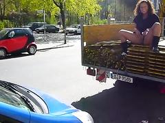 Amateur lass pissing on a car in public
