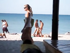 Craziest exhibitionist girl sucks two penises on the Crimean coast