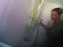 Tattooed chick gets clean in the shower