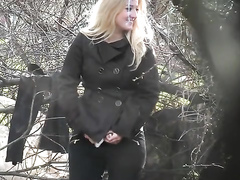 Blonde woman caught urinating in the woods
